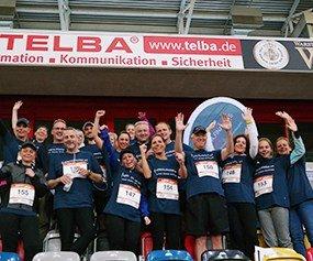 Das Team der ADELTA.FINANZ AG jubelt.